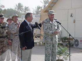 SECRETARY RUMSFELD AND POLISH ARMY GENERAL TYSZKIEWICZ at a ceremony at Camp Babylon, Iraq on September 6, 2003.
