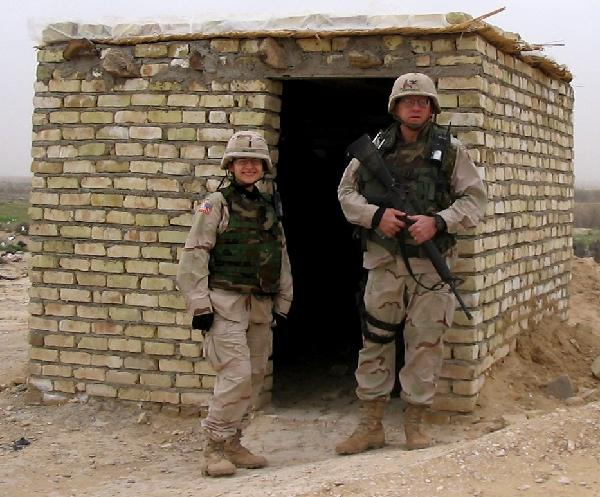 In February 2004 Lt Alicia Galvany (l) and I at the mud hut on the Iran-Iraq border where passports were stamped.